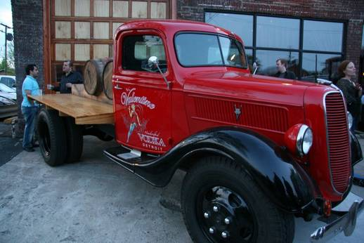 images of roaring cocktail with distilling room in background and delivery truck courtesy of valentines vodka